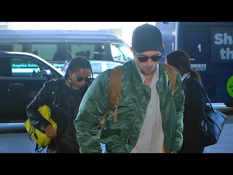 Robert Pattinson And Fiance FKA Twigs Jet Out Of LAX After Partying With Drake