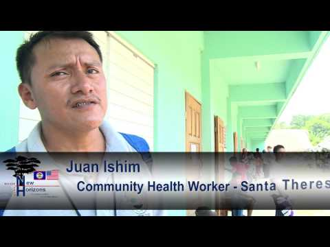 Ministry of Health personnel discuss New Horizons Belize 2014