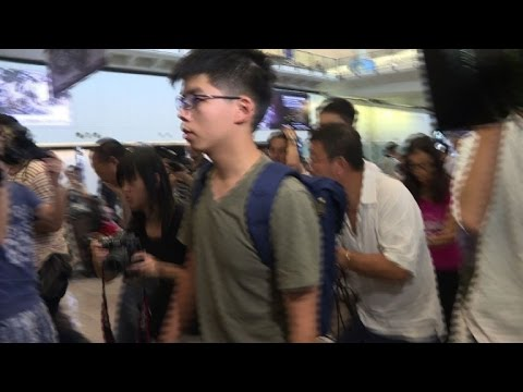 Hong Kong activist deported from Thailand returns home