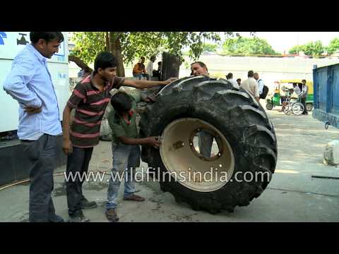 How to repair a punctured massive garbage truck tyre in India