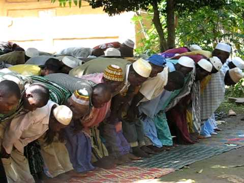 Muslim prayer ritual, West Africa village