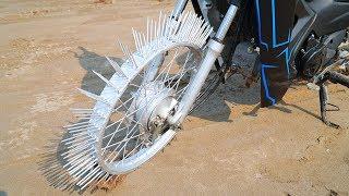 NTN - Thử Đi Xe Máy Bánh Gắn Đinh (Ride motorbike on Nails)