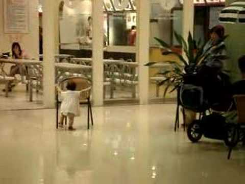 Zoe walks with a chair in Jusco - Huangdao