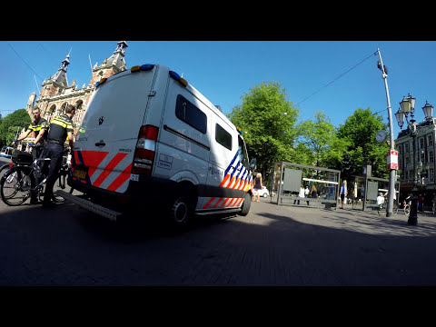 Amsterdam  4K ultra HD.  Cycling the old city  on a hot day.