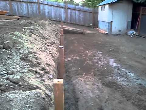 Sloping yard we made to levels an put wood wall - YouTube