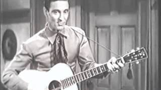 Ernest Tubb - Walking the Floor Over You (from the 1943 movie, Fighting Buckaroo)