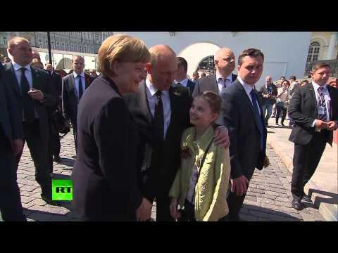 #Moscow, #Russia: Putin, Merkel cuddle kids, take photos in Kremlin