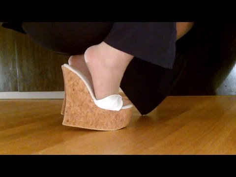 Cork wedge mules at home
