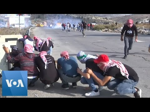 Palestinian Protesters Clash With Israeli Soldiers