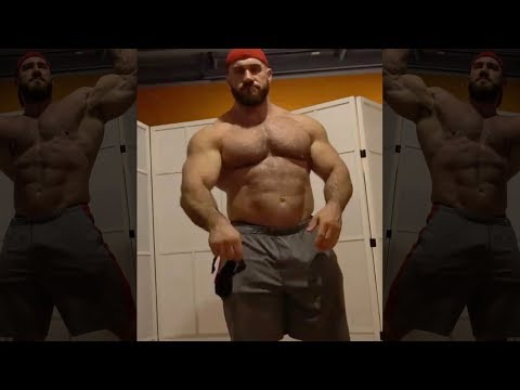 Hairy bodybuilder flexing