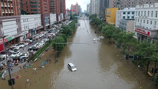 video: China braces for more rain as shocked residents pick through debris of deadly deluge