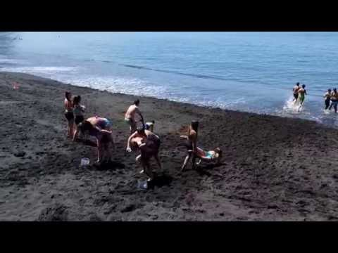 La Palma school class playing and learning social and physical skills  at  the black sand beach of T