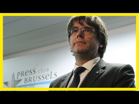 Sacked catalan leader carles puigdemont turns himself in to belgian police