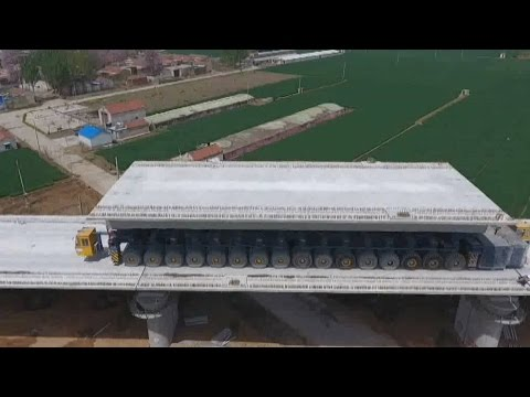 How gigantic high-speed railway girders are laid