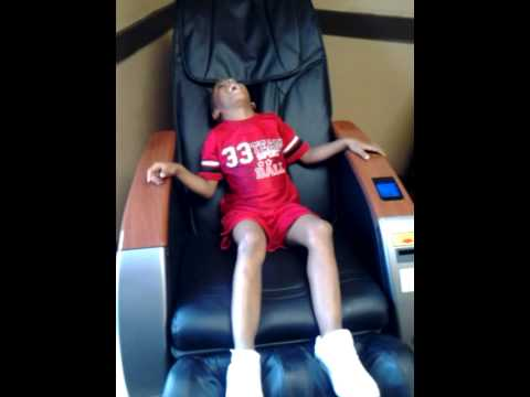 Delightful Funny Kid In Chair Laughs.