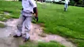 funny fall of a school boy in a park.3gp