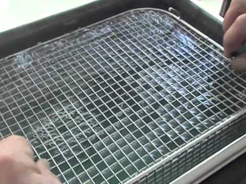 Ultrasonic cleaning of glass slides and vacuum jigs