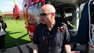 Midlands Air Ambulance show school children around the helicopter