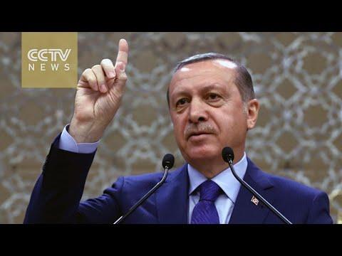 Erdogan says EU must do its part in migrant deal