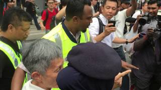 Demonstrators being arrested at Sogo shopping mall