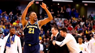 Second Round: Michigan downs Louisville