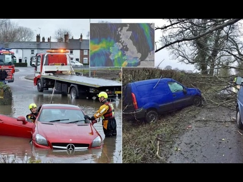 Storms bring huge waves, flash floods and leave cars smashed under fallen trees as fierce.