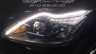 Тюнинг Ford Focus 2 в студии светостайлинга ALFA-CAR накладные ДХО внутрь фары