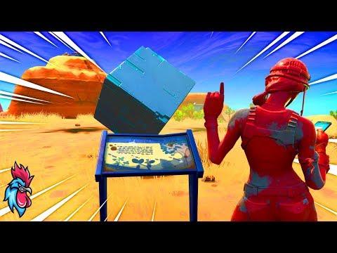 visiter-un-monument-commemoratif-du-cube-dans-le-desert-et-pres-d'un-lac---fortnite--