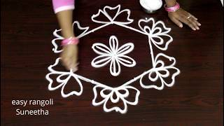 Creative kolam designs with 7 dots || Easy rangoli by Suneetha|| cute flower muggulu