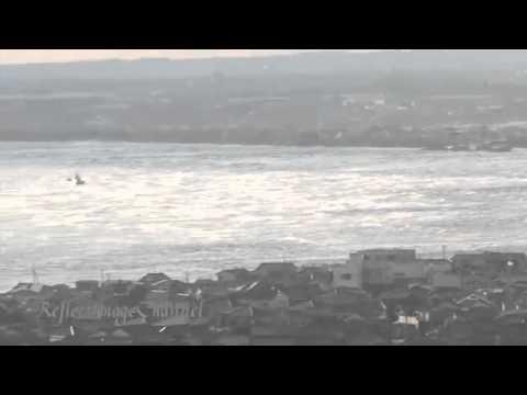 Japan. Tsunami hits Harbor Iioka between Sendai and Tokyo. Life footage - March 11, 2011.