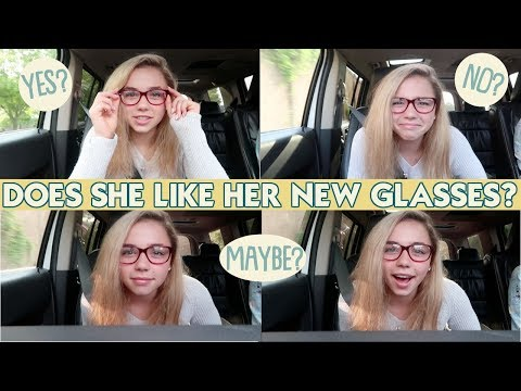 DOES SHE LIKE HER NEW GLASSES?