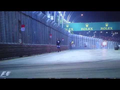 Fan walks out on track @ the Singapore GP F1 2015
