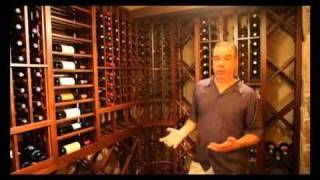 Custom Wine Cellar With Stone Arch Mural