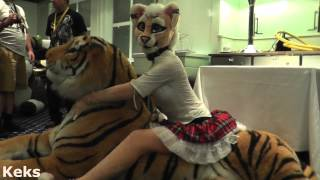 Belo4ka hugs an inflatable plush tiger