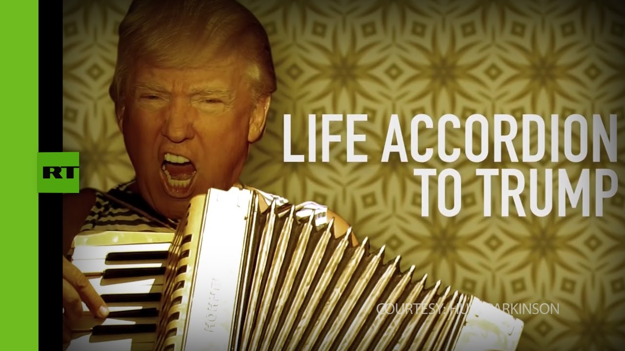 Trump 'plays' accordion while discussing Russian hacking & Mexico wall