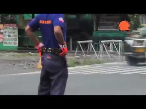 Dancing traffic enforcer moves and shakes to the beat