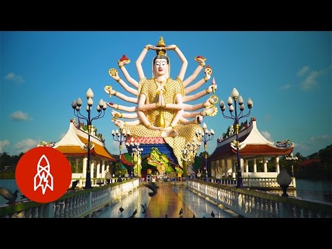 Tour This Tranquil Buddhist Island Temple of Giant Statues