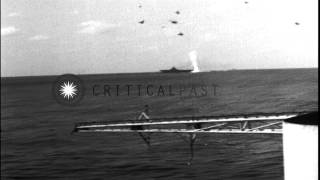 Iowa class BB, CV, CA and escorting DDs underway during Japanese air attack in th...HD Stock Footage