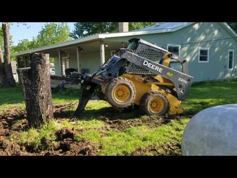 Quick attach stump bucket in action