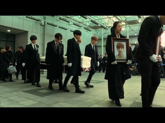 K-pop stars carry Jonghyun's coffin after suicide