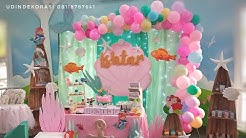 mermaid birthday decoration theme - dessert table and fabric backdrop decoration ideas