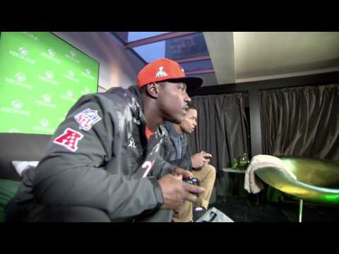 Seattle Seahawk Earl Thomas and Denver Bronco Knowshon Moreno Play Madden NFL 25 on Xbox One