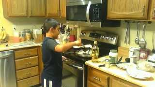 Andrew Cooking Egg Tacos