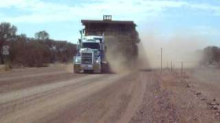 Kenworth with Cat 785 Dump truck on trailer