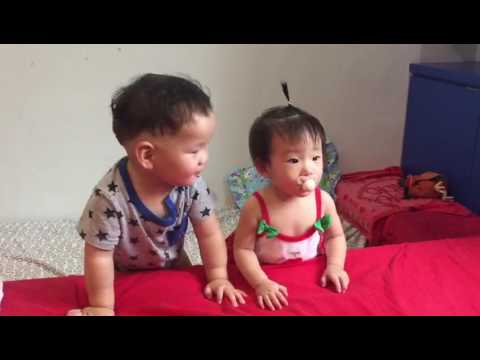 Babies fighting for pacifier