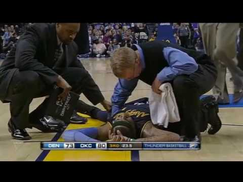 Nobody helps Carmelo Anthony as he collapses on court and play goes on