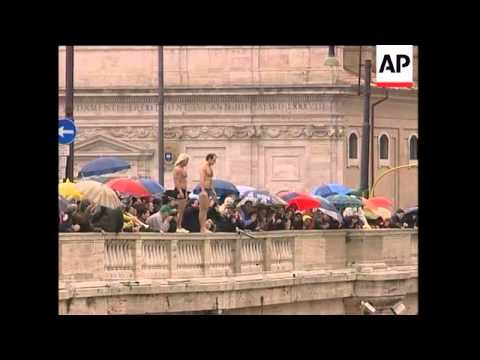 Swimmers jump into the river Tiber to celebrate the new year