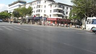Traffic in Suzhou, China. Mostly electric powered bicycles.