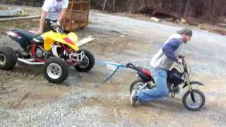 50cc dirt bike pulling off a yfz450