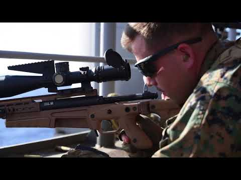 Marines & Sailors conduct live fire on floating target at sea